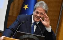 "Italian Prime Minister Paolo Gentiloni gestures as he delivers a speech during the end-of-year press conference, at ""Auletta"" of the parliamentary groups of the Chamber of Deputies, in Rome, on 28 December 2017. Picture: AFP"