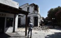 A pedestrian looks at the ruins of a bar on the island of Kos on 21 July 2017, where two patrons are said to have died following a 6.5 magnitude earthquake which struck the region. Picture: AFP.