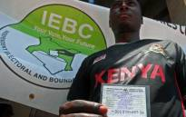 A potential voter in Kenya holds his card after undergoing the voter registration. Picture: AFP