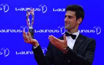 Tennis player Novak Djokovic of Serbia poses with his Laureus World Sportsman of the Year trophy at the Laureus World Sports 2016 Awards Ceremony in Berlin on 18 April, 2016. Picture: AFP.