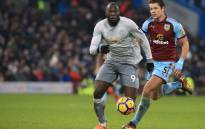 Manchester United's Belgian striker Romelu Lukaku (L) vies with Burnley's English defender James Tarkowski during the English Premier League football match between Burnley and Manchester United at Turf Moor in Burnley, north west England on 20 January 2018. Picture: AFP.