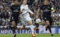 Real Madrid's Cristiano Ronaldo (C) vies with PSG defenders Marquinhos (R) and Presnel Kimpembe during their UEFA Champions League round of sixteen first leg football match at the Santiago Bernabeu stadium in Madrid on 14 February, 2018.