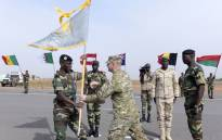 Senegals Army General Amadou Kane (L) receives the 2016 Flintlock flag from US Army General Donald Bolduc during the inauguration of a military base in Thies, 70 km from Dakar, on 8 February 2016 on the second day of a three-week joint military exercise between African, US and European troops, known as Flintlock.  Picture: Seyllou/AFP.