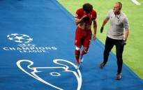 Liverpool's Egyptian forward Mohamed Salah (L) leaves the pitch after injury during the UEFA Champions League final football match between Liverpool and Real Madrid at the Olympic Stadium in Kiev, Ukraine on 26 May 2018. Picture: @MoSalah/Twitter.