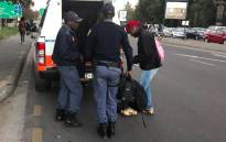 Police load arrested Huawei employees, who were protesting outside the company's offices in Sandton, into a van. Picture: Kgothatso Mogale/EWN