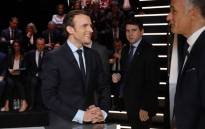 En Marche ! Movement Emmanuel Macron speaks with journalist Gilles Bouleau before taking part in a debate between five candidates for the French presidential election, organised by French private TV channel TF1, on 20 March, 2017 in Aubervilliers, outside Paris. Picture: AFP.