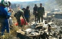 Indonesian soldiers examining the Hercules military plane A-1334 that crashed in Wamena on 18 December, 2016. Amilitary plane crashed in remote mountainous region of Indonesia's Papua, killing 13 people on board, military and police officials said. Picture: AFP.