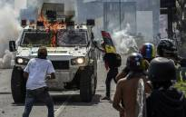 FILE: Opposition activists clash with riot police during a protest against President Nicolas Maduro in Caracas, on May 10, 2017. Picture: AFP