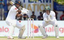 Dimuth Karunaratne plays a shot under the watchful eye of Proteas wicketkeeper Quinton de Kock during day one of the second Test in Colombo on 20 July 2018. Picture: @OfficialCSA/Twitter