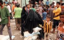 Yemeni women receive food aid in the coastal city of Hodeidah on 14 June, 2018. Picture: AFP.
