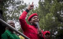 The EFF's Mbuyiseni Ndlozi addresses hundreds of protesters on the stage of the Day of Action march against the leadership of President Jacob Zuma in Pretoria on 12 April 2017. Picture: Reinart Toerien/EWN