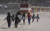 The young people of the Waves for Change NGO get ready to surf. Picture: Supplied.