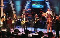 FILE: The Eagles (from left:) Randy Meisner, Timothy Schmit, Glenn Frey, Don Felder, Joe Walsh, Don Henley and Bernie Leadon, appear together on stage after receiving their awards and being inducted into the Rock & Roll Hall of Fame in 1998. Picture: AFP