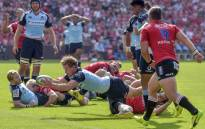 Waratahs' s Australian winger Michael Hooper (C) scores try during the SuperRugby match between Emirates Lions and Waratahs at the Emirates Airline Park-Johannesburg, on 4 March 2017 in Johannesburg. Picture: AFP.