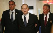 Harvey Weinstein is escorted in handcuffs into the State Supreme Court after on Monday for arraignment on charges alleging he committed a sex crime against a third woman on 9 July 2018 in New York City. Picture: AFP.