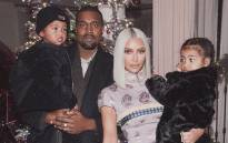 Kanye West (left) and Kim Kardashian with their two children. Picture: @KimKardashian/Twitter