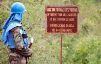 FILE: A UN peacekeeper stands near a board forbidding hunting in the Virunga National Park in the Democratic Republic of Congo. Picture: AFP