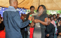 FILE: Lethabo Rabalago sprays insecticide on a follower. Picture: Facebook.
