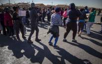 Residents of Protea Glen have shut down their community, protesting against illegal land invaders who they say will devalue their properties and endanger their children. Picture: Thomas Holder/EWN