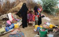 FILE: Yemeni families stand in the remains of houses in a neighbourhood affected by Tropical Cyclone Sagar, in the port city of Hodeidah, on 19 May 2018. Picture: AFP