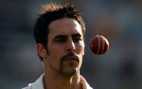 Australia's paceman Mitchell Johnson tosses a ball. Picture: AFP.