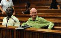 Former Nigerian Olympic athlete Ambrose Monye (L) and Andre Gouws (R), accused of murdering Chanelle Henning, appear in the North Gauteng High Court on 21 November 2012. Picture: Werner Beukes/SAPA