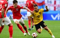 England's defender John Stones (left) vies with Belgium's forward Eden Hazard during their Russia 2018 World Cup play-off for third place football match between Belgium and England at the Saint Petersburg Stadium on 14 July 2018. Picture: AFP.
