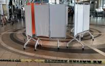 Screens have been put up inside the Cape Town International Airport after an early morning shooting on 18 October 2017. Picture: Lauren Isaacs/EWN