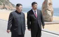This photo released on 8 May 2018 by China's Xinhua News Agency shows North Korean leader Kim Jong Un meeting with Chinese President Xi Jinping in Dalian, in northeast China's Liaoning province. Picture: AFP.