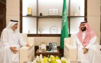 A handout picture provided by the Saudi Press Agency (SPA) shows Saudi Crown Prince Mohammed bin Salman (R) meeting with Qatari envoy Sheikh Abdullah bin Ali bin Jassim al-Thani in Jeddah on 16 August 2017. King Salman has ordered the reopening of the border with Qatar to hajj pilgrims. Picture: AFP.