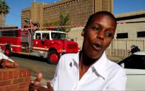 Zanale at the scene of the fire in Braamfontein. She's been dubbed Jozi's new and hottest reporter by social media. Picture: EWN.