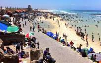 FILE: Holiday makers enjoy the beach. Picture: EWN