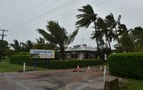 FILE: Palm trees blow in the wind in the town of Ayr in far north Queensland as Cyclone Debbie approaches on March 28, 2017. Picture: AFP