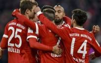 FILE: Bayern Munich's German forward Thomas Mueller (L) is congratulated by teammates after he scored the team's 100th goal during the German first division Bundesliga football match Bayern Munich vs Werder Bremen in Munich, southern Germany, on 21 January 2018. Bayern won 4-2. Picture: AFP.