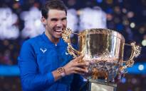 Rafael Nadal of Spain holds the trophy after winning the men's singles final match against Nick Kyrgios of Australia at the China Open tennis tournament in Beijing on 8 October, 2017. Picture: AFP.