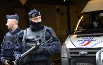 FILE: French police officers stand guard in front of the headquarters of French newspaper Liberation as editorial staff of French satirical weekly newspaper Charlie Hebdo and Liberation meet, on 9 January 2015 in Paris, after a deadly attack that occurred on 7 January by armed gunmen on the Paris offices of Charlie Hebdo. Picture: AFP.
