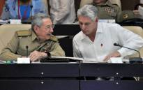 FILE: Cuban President Raul Castro (L) and First Vice president Miguel Diaz-Canel speak during the Permanent Working Committees of the National Assembly of the People's Power in Havana, on 14 July 2017. Picture: AFP
