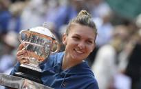 Simona Halep holding the trophy after winning the French Open final against Sloane Stephens. Picture: @rolandgarros/Twitter.