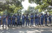 Police officers guard the Hoerskool Overvaal on 17 January 2018 following protests over an admissions row between the school and the Gauteng Education Department. Picture: Ihsaan Haffejee/EWN