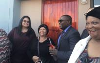 Sixty-year old Beatrice Bowers (second from left) receives keys to her new home from Human Settlements MEC Bonginkosi Madikizela. She's been on the housing list for 23 years. Picture: Monique Mortlock/EWN.