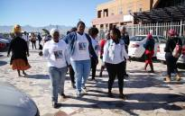 FILE: Members of the community outside the Khayelitsha magistrates court, wearing T-shirts with the Iyapha Yamile's face printed on the front. Picture: Bertram Malgas.