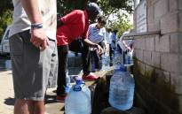 FILE: Cape Town residents collecting water at the Newlands springs in Cape Town. Picture: Bertram Malgas/EWN.