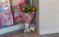 Flowers laid outside entrance 4 of Northgate Mall where the body of Klara Göttert's body was found. Picture: Louise McAuliffe/EWN