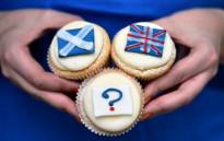 FILE: Referendum cupcakes featuring a Scottish Saltire, (L) a Union flag (R) and a question mark (Below) symbolising the 'undecided voter' are pictured at a bakery in Edinburgh in 2014. Picture: AFP.