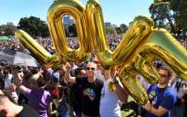 "Supporters of the same-sex marriage ""Yes"" vote gather to celebrate the announcement in a Sydney park on 15 November 2017. Picture: AFP"