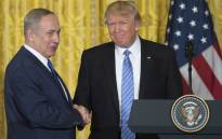 US President Donald Trump (R) and Israeli Prime Minister Benjamin Netanyahu shake hands following a joint press conference in the East Room of the White House in Washington, DC, February 15, 2017. Picture: AFP