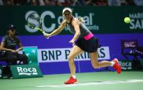 Denmark's Caroline Wozniacki in action during her group stage match with Romania's Simona Halep. Picture: @WTA/Twitter.