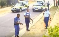 FILE: Screengrab of police officers who have been arrested for the murder of 32-year-old Khulekani Mpanza, who was caught by police for an attempted robbery.
