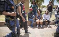 FILE: Students watch as police arrest a protesting student at the Cape Peninsula University of Technology Bellville Campus. Picture: Thomas Holder/EWN