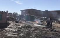 Alexandra residents are trying to rebuild their homes after 120 shacks burnt. Picture: Masego Rahlaga/EWN.